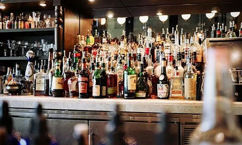 The Best Pubs for Celebration Events in the UK whiskey bottles bar - The Best Pubs for Celebration Events in the UK